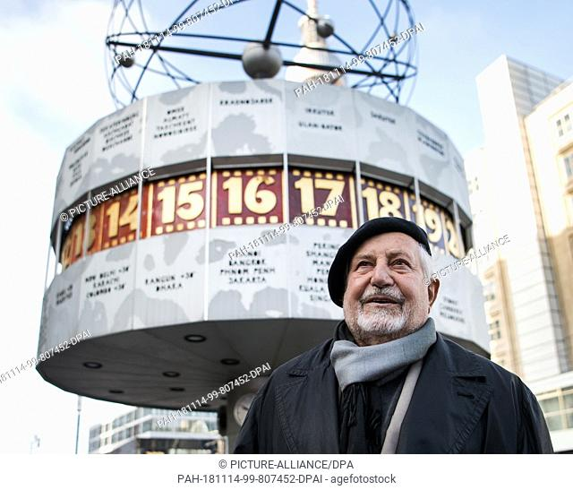 14 November 2018, Berlin: Erich John, designer of the world time clock, stands in front of the world time clock at Alexanderplatz. On 30.09