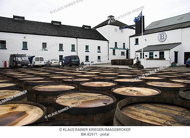 Used casks laying in the yard of Bruichladdich distillery, get recycled and filled again. Isle of Islay, Scotland