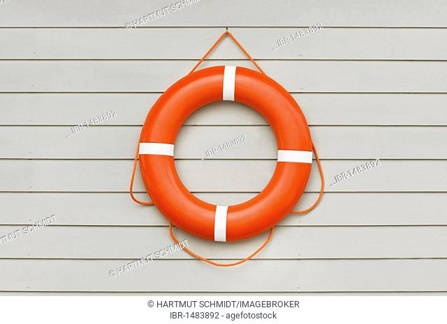 Lifesaver on wooden wall, water rescue