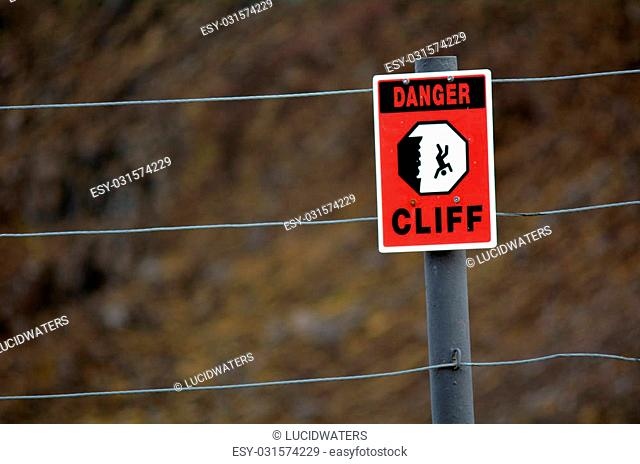 Danger Cliff sign and symbol. concept photo of danger and risk taking. copyspace
