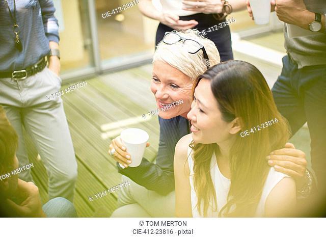 Businesswomen smiling in courtyard