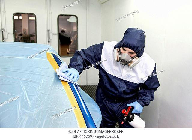 Vehicle painter prepares a partial paint, degreasing the parts to be painted on the car, Düsseldorf, North Rhine-Westphalia, Germany