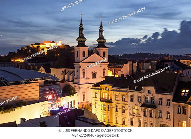 Overview at dusk with illuminated Dominican church and Spilberk castle. Brno, Czech Republic