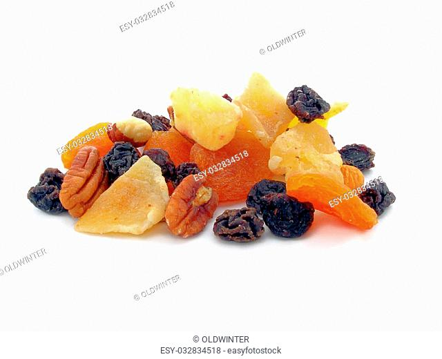 Delicious mixed dried fruit close up to be eaten or cake ingedients isolated over white background