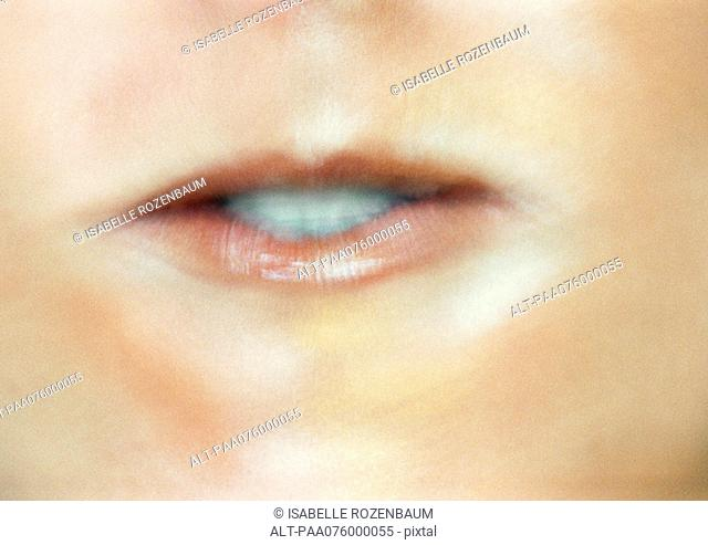 Close up of woman's mouth making expression
