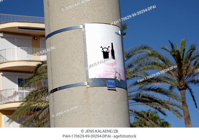A sign forbids excessive drinking from buckets and loud music at the Playa de Palma in Palma De Mallorca, Spain, 13 June 2017