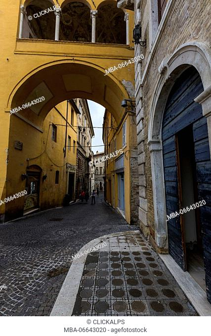 A typical alley and architecture of the old town of Fermo Marche Italy Europe