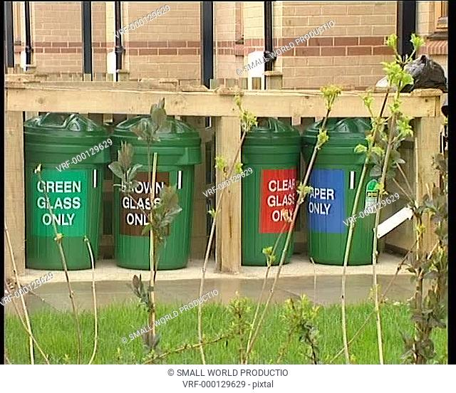 Recycling bins outside early 90s green homes