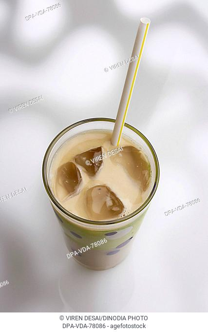 Drink Cold coffee with ice and straw against white pattern background