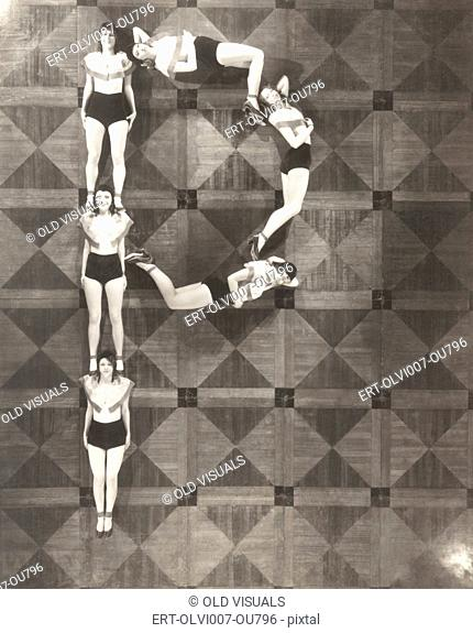 High angle view of women forming the letter P (OLVI007-OU796-F)