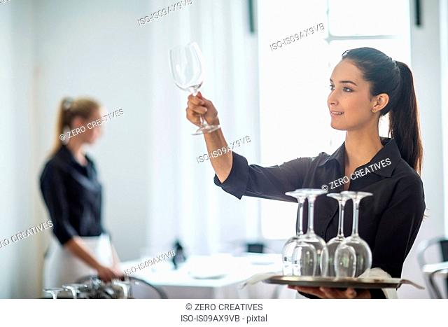 Waitresses setting table in restaurant