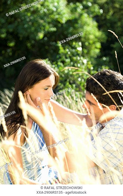 couple relaxing on meadow