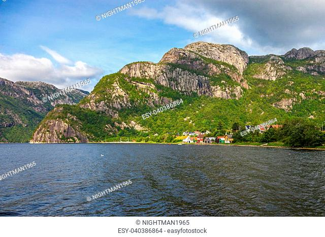 Norwegian landscape with houses and huts on the shore of the fjord