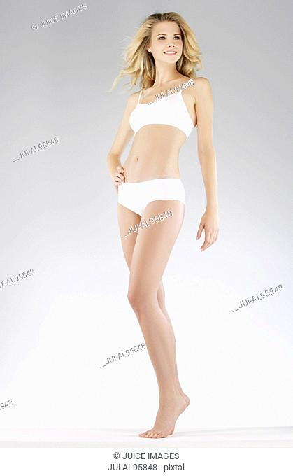 Young woman posing in underwear, portrait