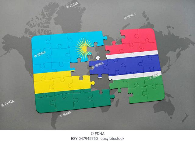 puzzle with the national flag of rwanda and gambia on a world map background. 3D illustration
