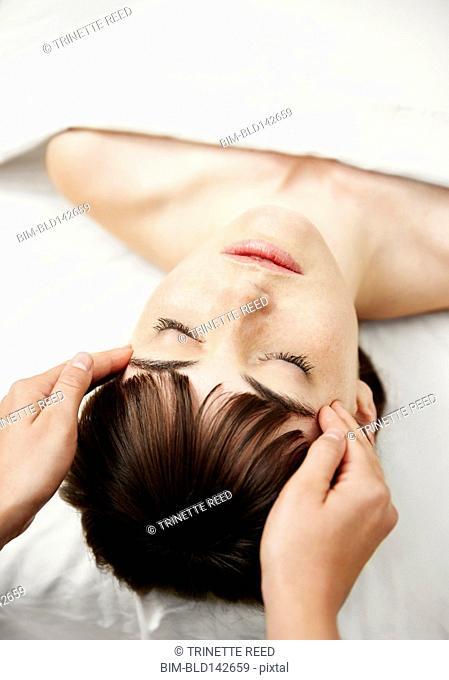 Woman having scalp massage in spa