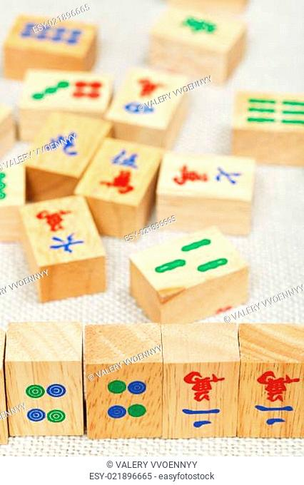 wood tiles in mahjong game on textile table