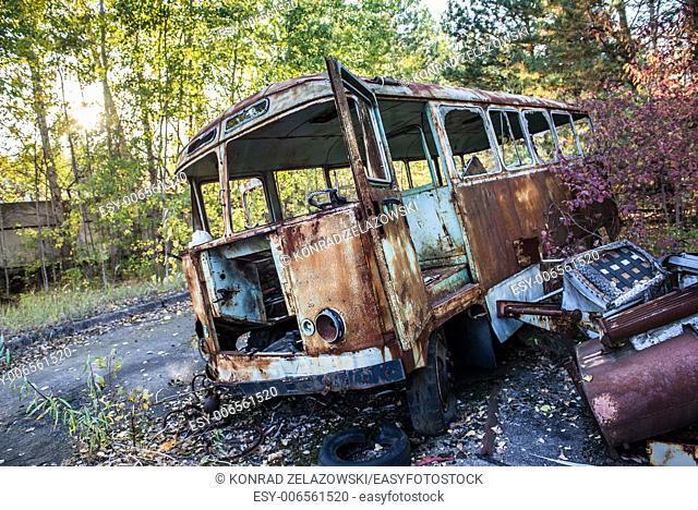 rusty bus in Jupiter Factory in Pripyat ghost town, Chernobyl Nuclear Power Plant Zone of Alienation, Ukraine