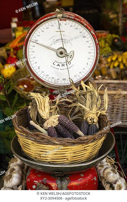 Rome, Italy. Fruit and vegetable stall at the daily market in the Campo dei Fiori. Weighing scales with basket of corn ears