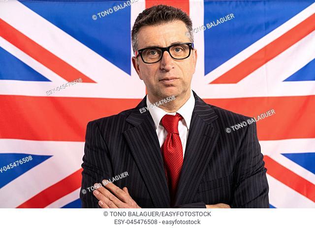 English UK businessman with suit on british flag