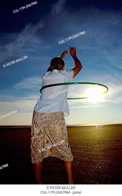 woman with hoop around waist