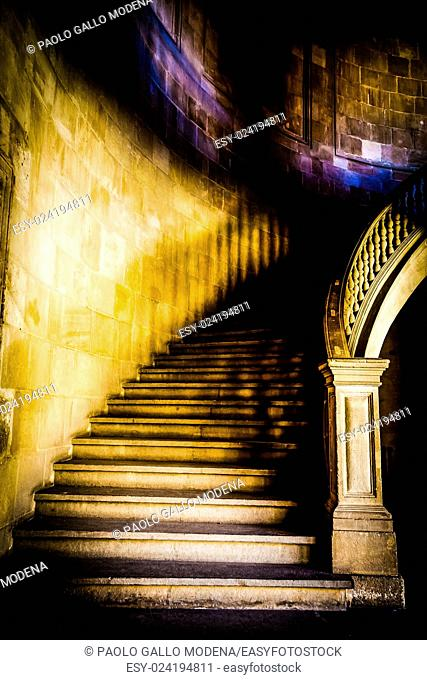 Old staircase made of pure white marble in gothic mood