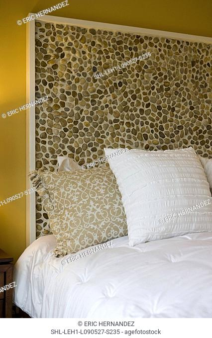 Stone headboard of bed