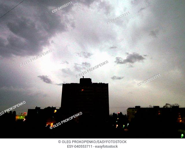 Lightning and thunder at night in the city it's raining