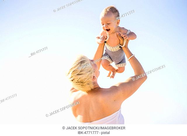 Attractive blond mother with 4 months old baby boy, Portugal