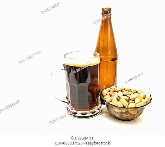 dark beer and pistachios closeup on white background