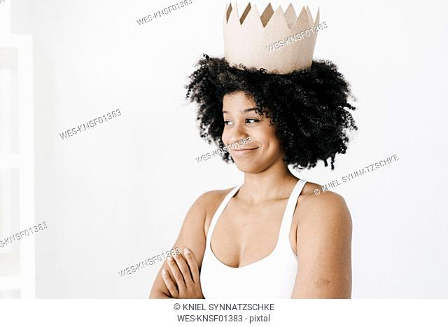 Fit young woman wearing paper crown