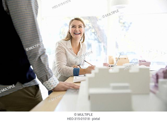 Smiling architects meeting in office