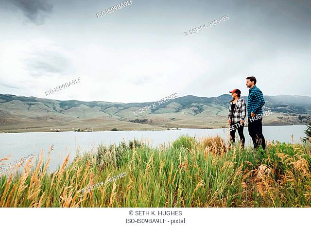 Couple walking near Dillon Reservoir, looking at view, Silverthorne, Colorado, USA