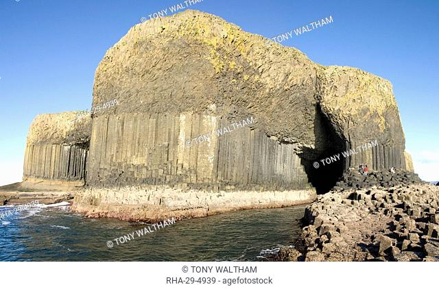 Columnar basalt lava with Fingal's Cave cut into it by sea, Staffa, off west coast of Mull, Inner Hebrides, Scotland, United Kingdom, Europe