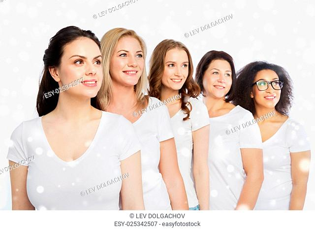 friendship, diverse, body positive and people concept - group of happy different size women in white t-shirts over snow