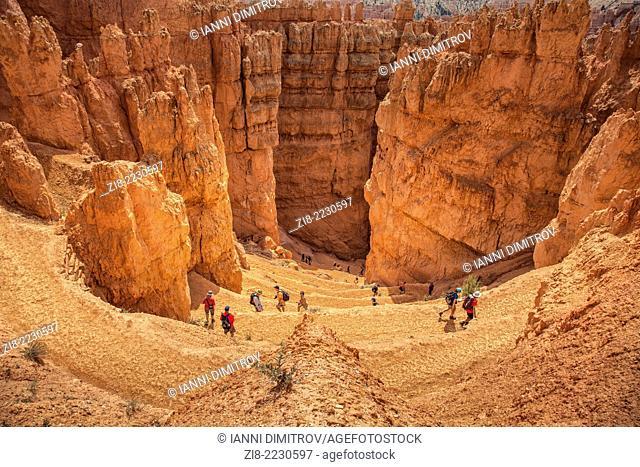 Tourists trecking the rocky landscape ,Bryce Canyon,Utah,USA