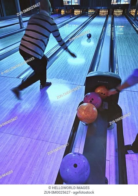 Man in action at bowling alley, Stockholm, Sweden, Scandinavia