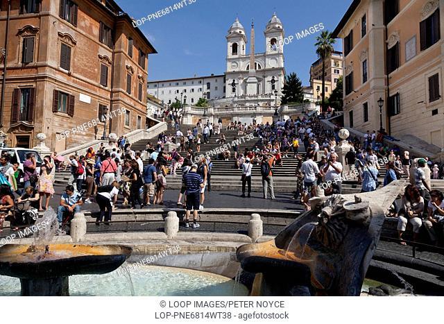 The spanish steps and the Santissima Trinita dei Monti covered in tourists