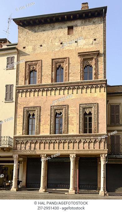 view of historical Renaissance building on Erbe square called the Merchant House, shot in bright light at Mantua, Lombardy, Italy