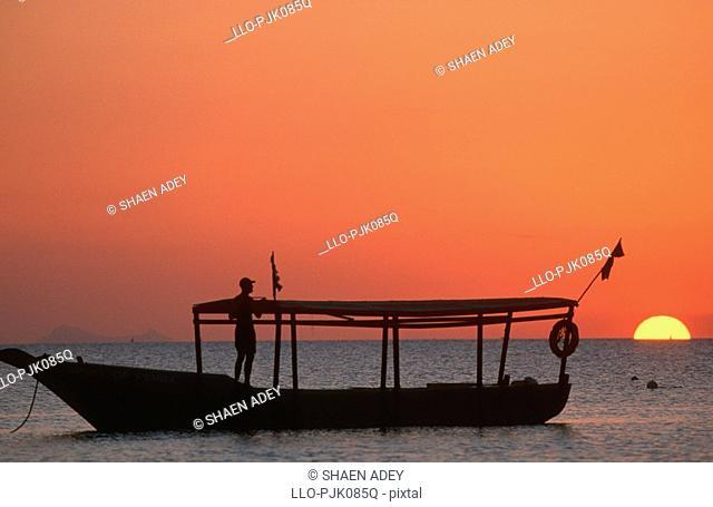 Spirit of Pemba dive boat, silhouetted at sunset, Nungwi, Zanzibar