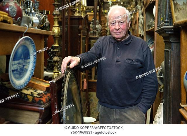 Tilburg, Netherlands. Portrait of the 72 year old owner of an antique wholesale company on the eastern industrial estate in town
