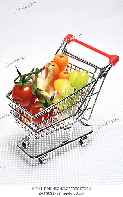 Fruit and veg in a mini shopping trolley