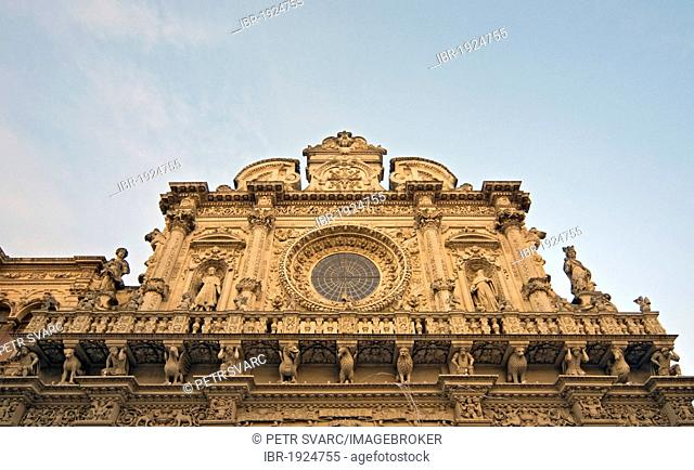 Richly decorated facade with rose window or Catherine window of Baroque Basilica di Santa Croce, Church of Holy Cross, completed in 1695, Lecce, Apulia, Puglia