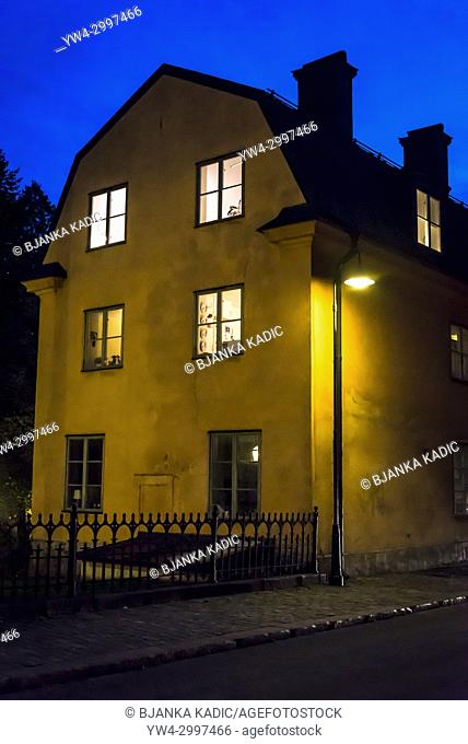 House with lighted windows at dusk, Sodermalm, Stockholm, Sweden