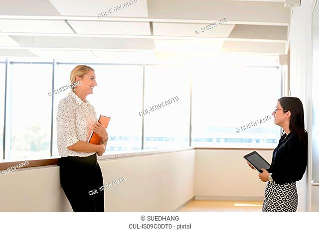 Colleagues having discussion at corridor