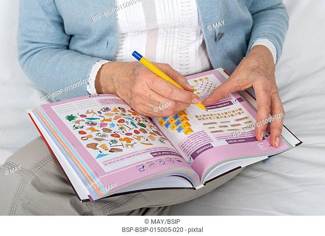 Senior woman doing memory and logic games