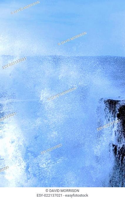 waves crashing on burren cliffs