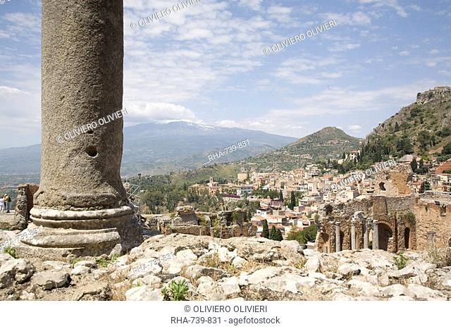 Mount Etna viewed from the Greek and Roman theatre, Taormina, Sicily, Italy, Europe