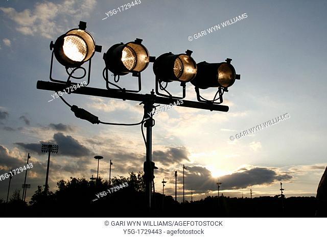 row of studio type spot lights outdoors