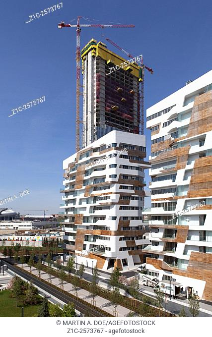 Citylife, a new residential and business district in Milan, Italy. Zaha Hadid Residences in foreground,in background Isozaki Tower under construction